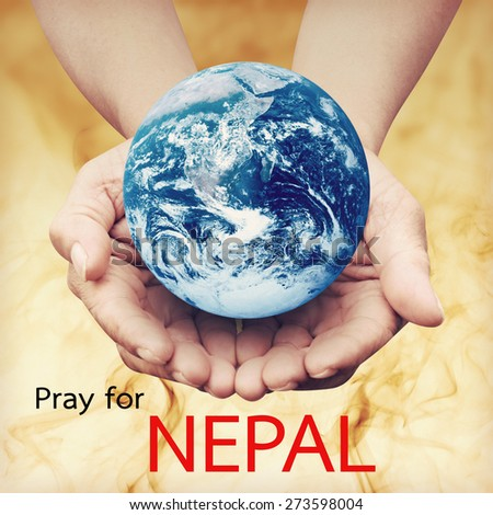 Pray for NEPAL Earthquake Crisis nature abstract on helping hands Elements of this image furnished by NASA - stock photo