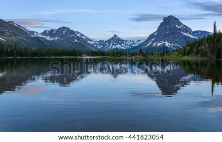Pray Lake - A spring evening view of Pray Lake and its surrounding mountains at Two Medicine Valley region of Glacier National Park, Montana, USA. - stock photo