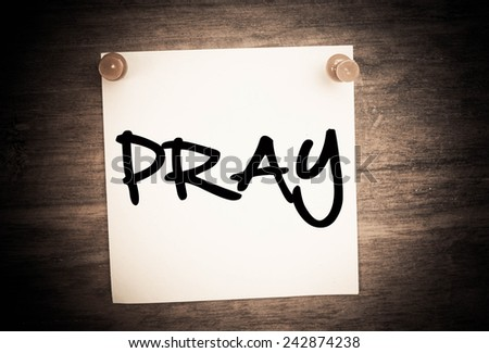 pray text concept on note paper - stock photo