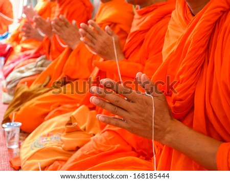 pray, the monks and religious rituals in thai ceremony  - stock photo