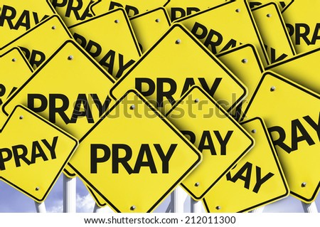 Pray written on multiple road sign  - stock photo