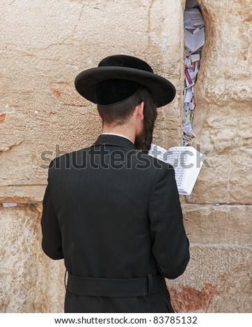 Prayer at the wailing wall. Jerusalem - stock photo