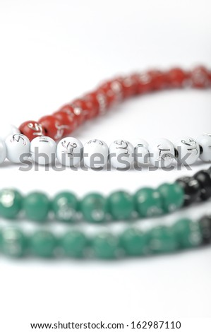Prayer beads with UAE national flag colors - stock photo