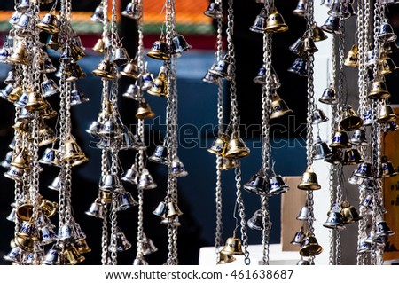 Prayer Bells. Thailand. Hanged many bells in a row. Buddhist bells lucky charms in Thailand.