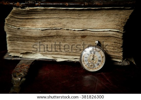 Prayer-book in Old Russian and a pocket watch