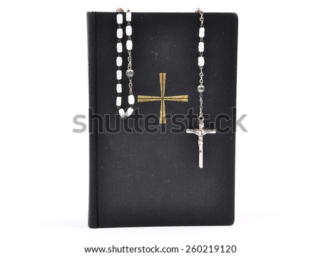 Prayer book with chaplet - stock photo