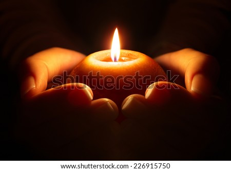 prayer - candle in hands  - stock photo