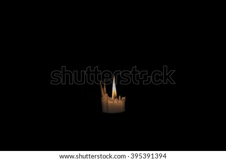 Prayer candle light up the darkness in a church - stock photo
