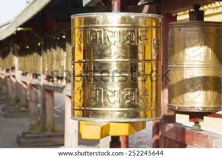 Prayer drums with mantras in one of the Buddhist temples in Mongolia - stock photo