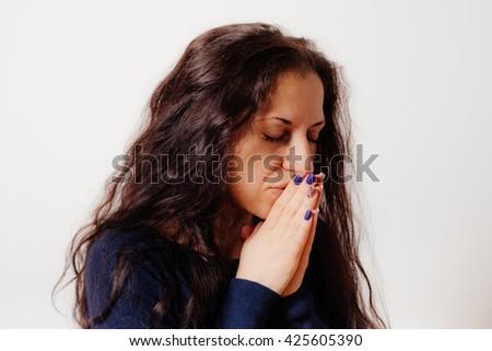 Prayer. Female. - stock photo