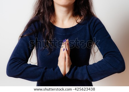 Prayer. Female. - stock photo