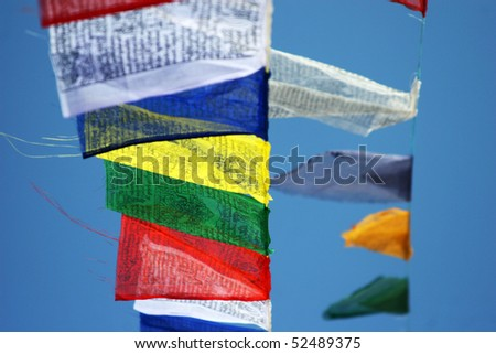 Prayer flags against a background of the blue sky