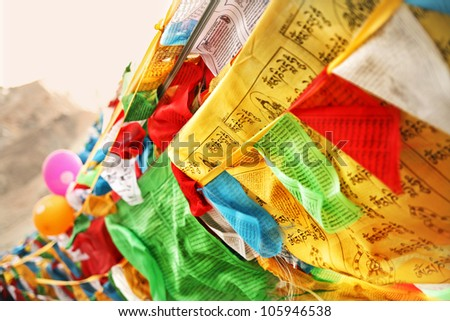 Prayer flags and balloons at Mount Everest Base Camp in Tibet China - stock photo