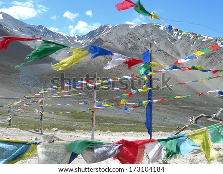 Prayer flags and Tibetan symbols at a road side in the Himalayas, India
