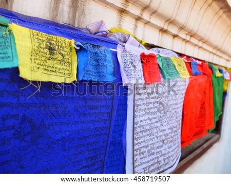 Prayer flags hanging around temple in Nepal