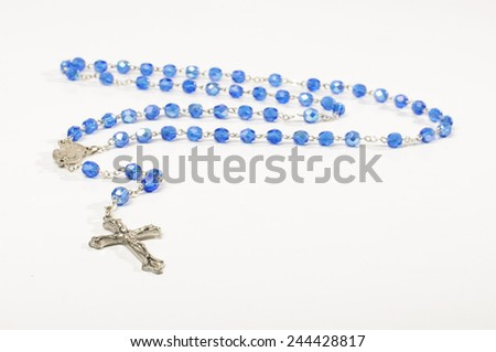 Prayer rosary isolated on the bright background