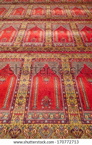 Prayer Rug. Red carpet in a historical Ottoman mosque in Turkey.