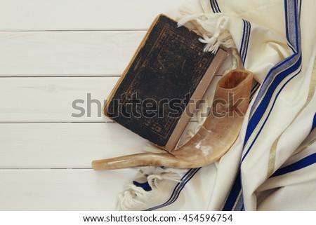 Prayer Shawl - Tallit and Shofar (horn) jewish religious symbol - stock photo