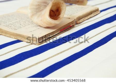 Prayer Shawl - Tallit, jewish religious symbol. Selective focus - stock photo