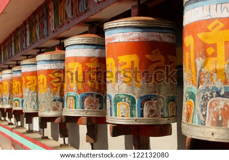 Prayer wheels at Zang Dhok Palri Phodang, a Buddhist monastery in Kalimpong in West Bengal, India. - stock photo