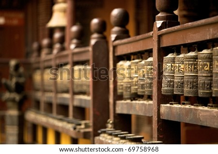 prayer wheels in the beautiful golden temple in patan, nepal