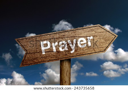 Prayer wooden road sign with cloud and blue sky background. - stock photo