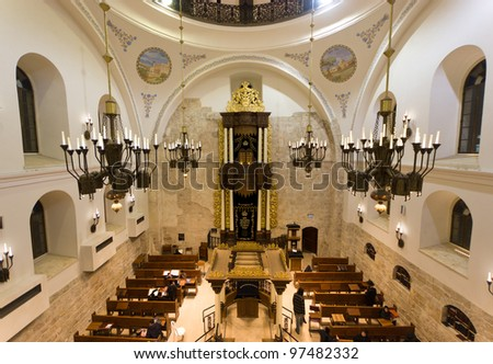 "prayers at the newly renovated ""Hurva"" synagogue at the old city of Jerusalem - it is the most important in the old city - stock photo"