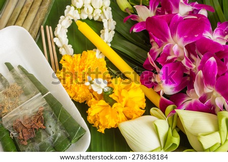 praying buddha set orchid flowers incense lotus and candles - stock photo