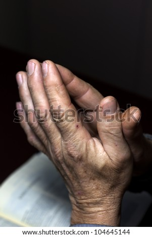 praying hands and bible - stock photo
