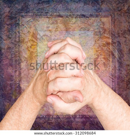 praying hands over colorful grunge frame background - stock photo