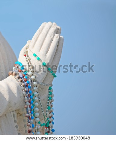 praying hands with rosary beads