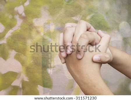 praying hands with the image of guitar in nature background and lightening effect - stock photo