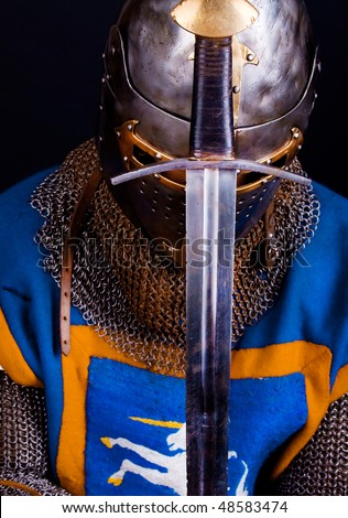Praying knight with his sword - stock photo