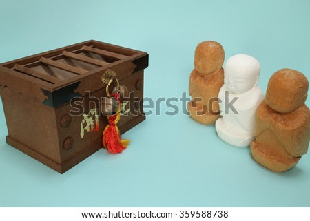 "praying ksitigarbha and the offertory box in blue Note: Japanese word of this photo means ""better fortune - stock photo"