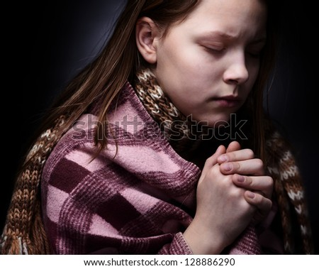 Praying little girl - stock photo