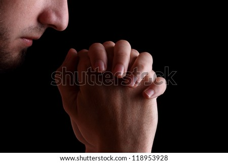Praying man - stock photo