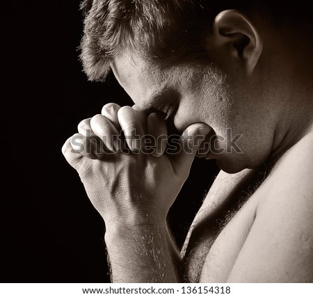 Praying man. MANY OTHER PHOTOS FROM THIS SERIES IN MY PORTFOLIO. - stock photo