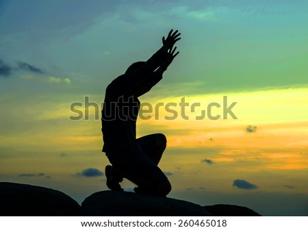 praying man on beautiful sky background - stock photo