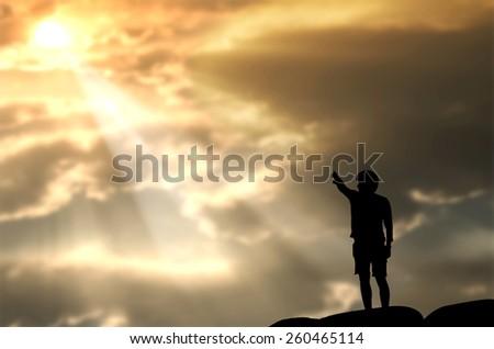 praying man on beautiful sky background - stock photo