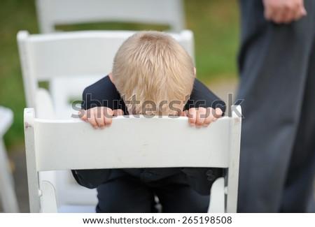 Praying ring bearer - stock photo