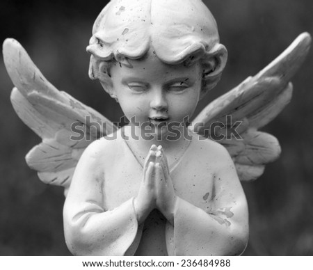 praying sweet angel figurine  - stock photo