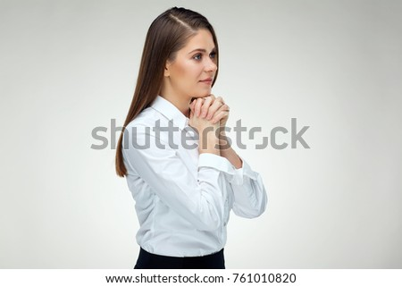 Praying woman portrait on white isolated background. Young woman christian prayer.