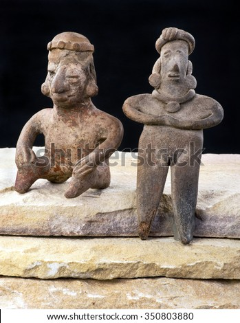 Pre Columbian Colima woman and warrior made around 200 BC . - stock photo