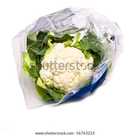 Pre Packed Cauliflower in plastic bag isolated against white background. - stock photo