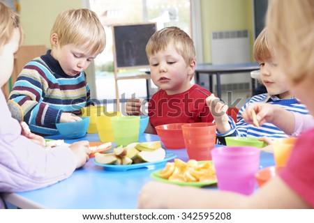 Pre School Children Eating Healthy Snacks At Breaktime - stock photo