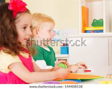 pre-school children in the classroom - stock photo