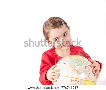 Pre-schooler girl with globe isolated on white with copy space for text.