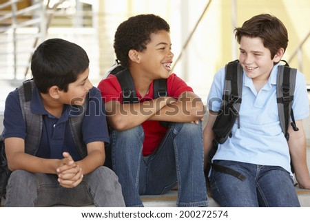 Pre teen boys in school - stock photo