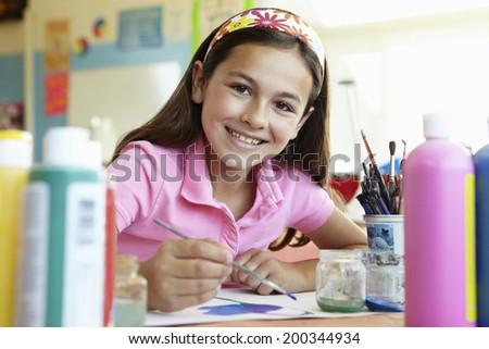 Pre teen girl in art class - stock photo