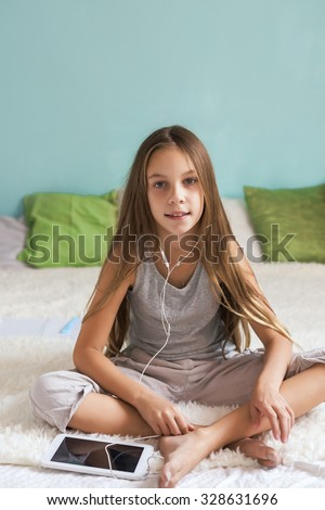 Pre teen girl relaxing bed listening stock photo 328631696 for Teen home pic